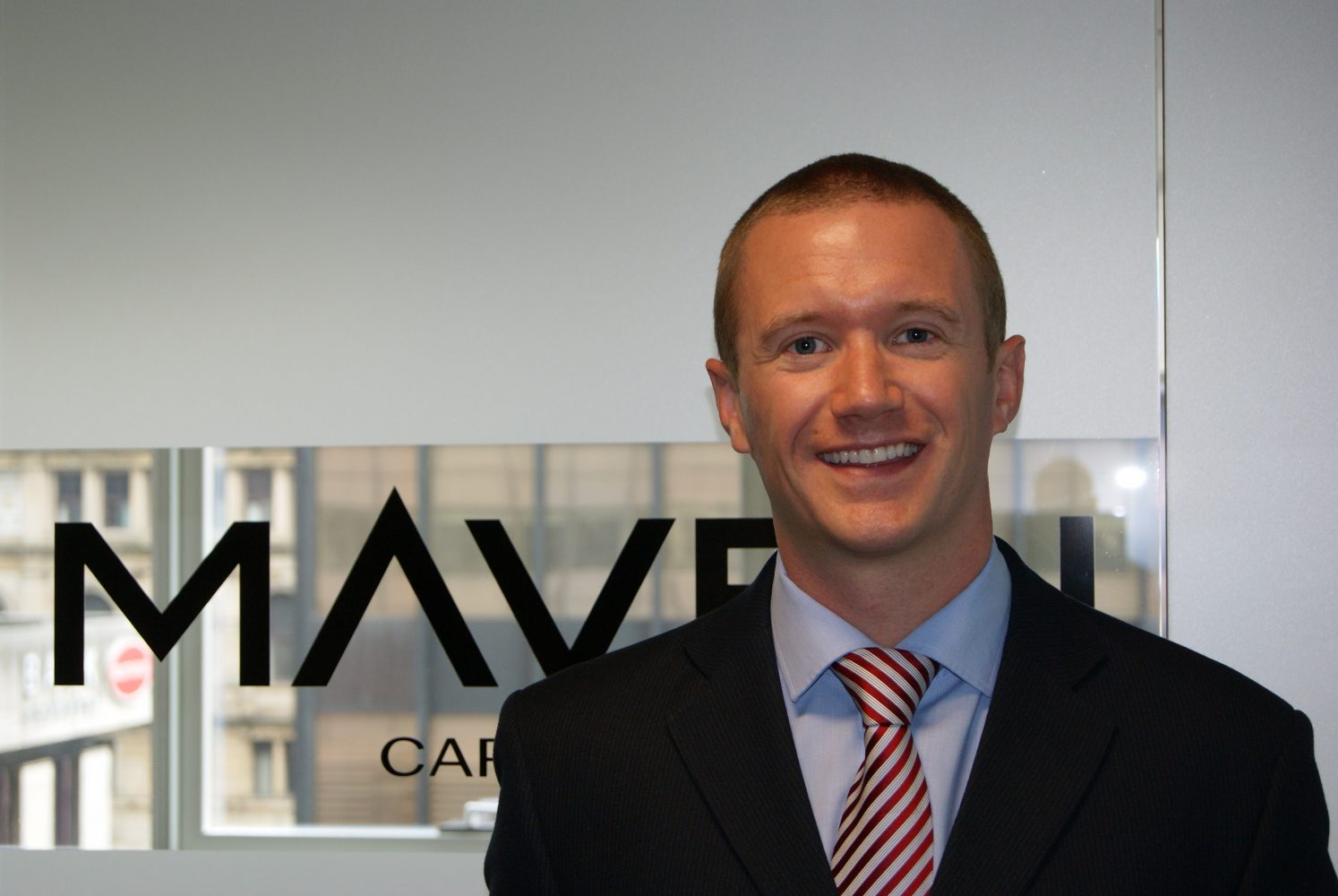 A headshot of Ryan Bevington, the Investment Director at Maven