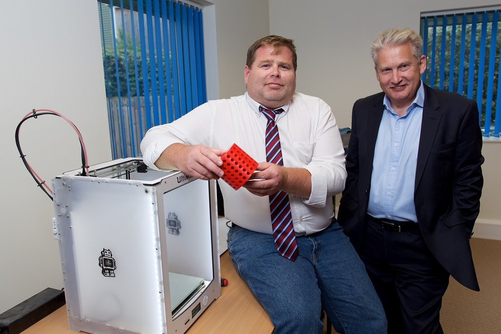 2 men from Hydrotherm showing their water heating product