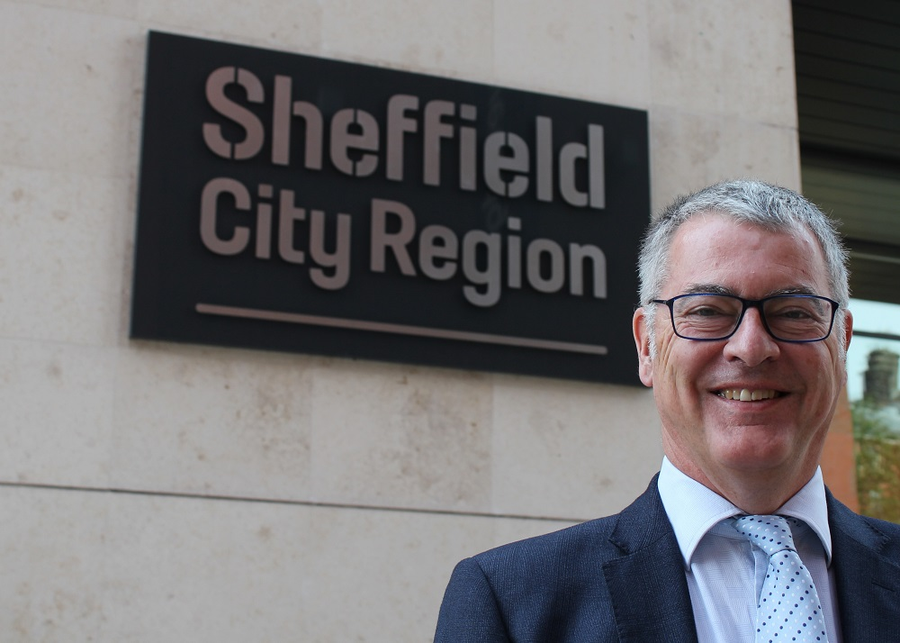 Neil MacDonald, NPIF Strategic Oversight Board Member stood outside a building with a Sheffield City Region sign