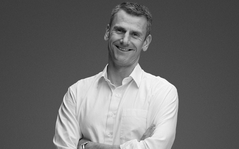 A headshot of Ben Hookway, CEO at Relative Insight smiling with his arms crossed