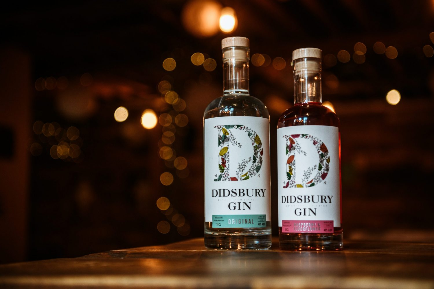 2 bottles of Didsbury Gin rested on a table