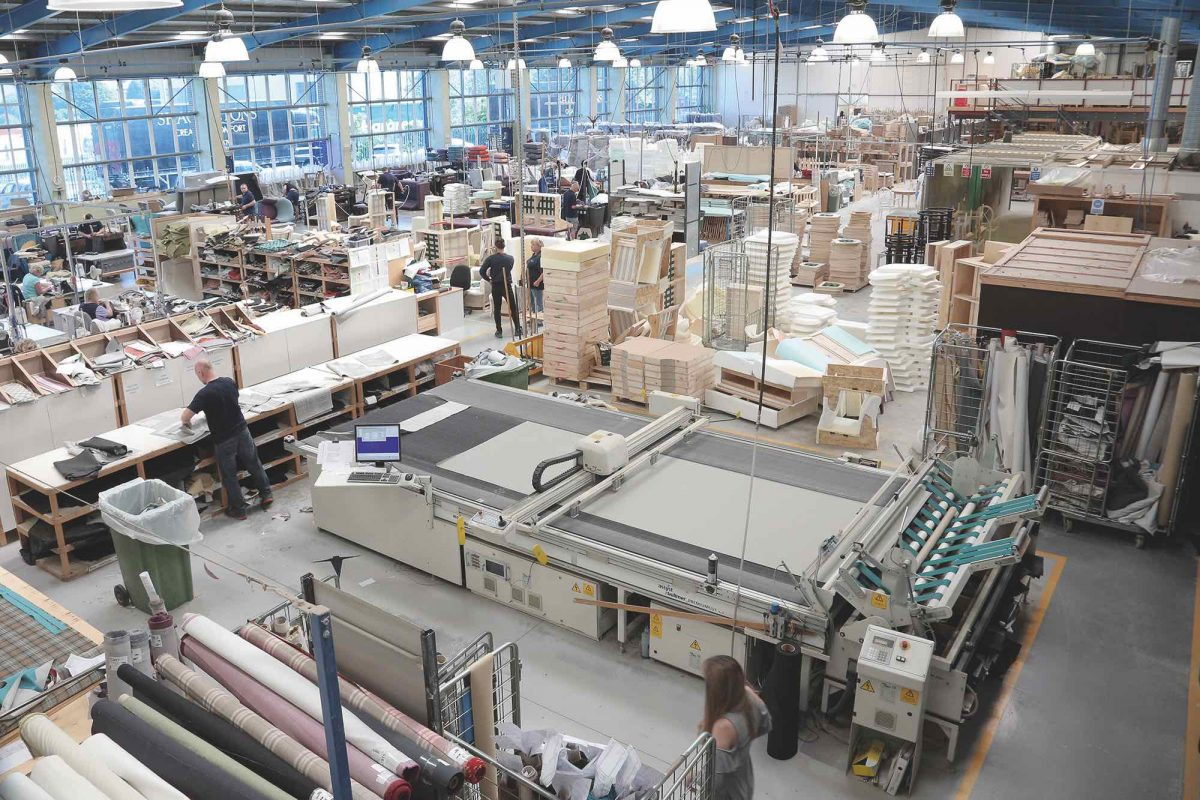 View from height of the factory floor at Shackletons furniture manufacturers, showing workers and machinery